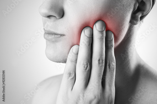 Fotografía  Man with a toothache. Pain in the human body