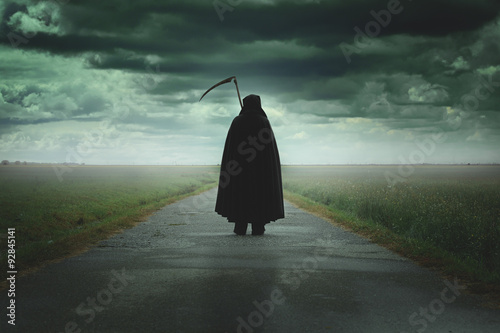Grim reaper walking a desolate road Poster