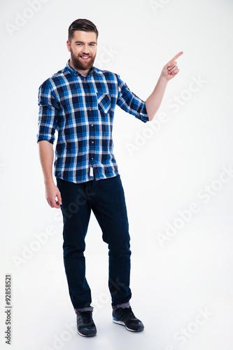 Fotografía  Full length portrait of a casual man pointing finger away