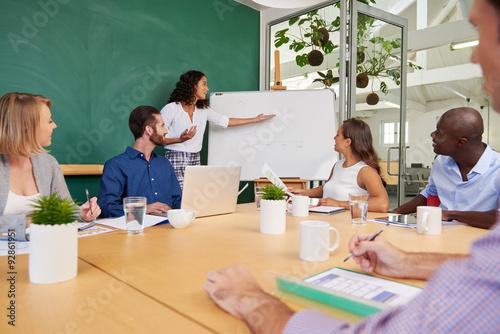 Fotografie, Obraz  businesswoman presenting productivity chart