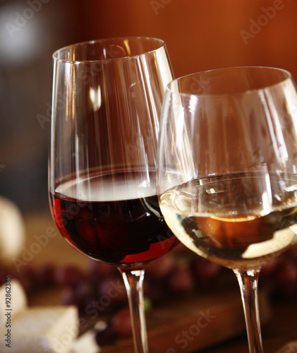 Elegant glasses of red and white wine Fototapeta