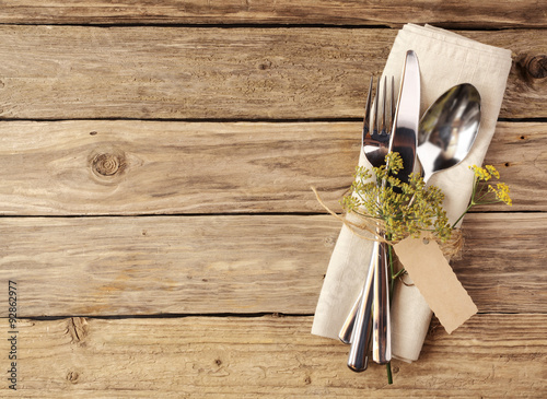 Fotografie, Obraz  Cutlery Tied on Napkin with Small Leaves and Tag
