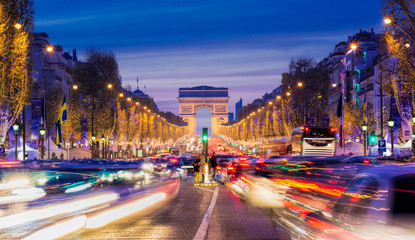 FototapetaAvenue des Champs-Elysees with Christmas lighting leading up to the Arc de Triomphe in Paris, France