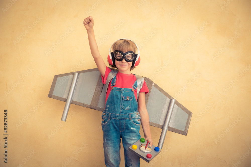 Fototapety, obrazy: Happy child with toy jetpack playing at home
