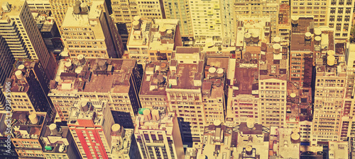 Vintage filtered panoramic view of Manhattan roofs. #92875906