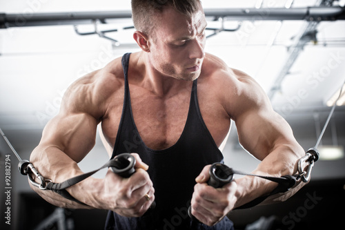 plakat Bodybuilder doing butterfly on cable pull