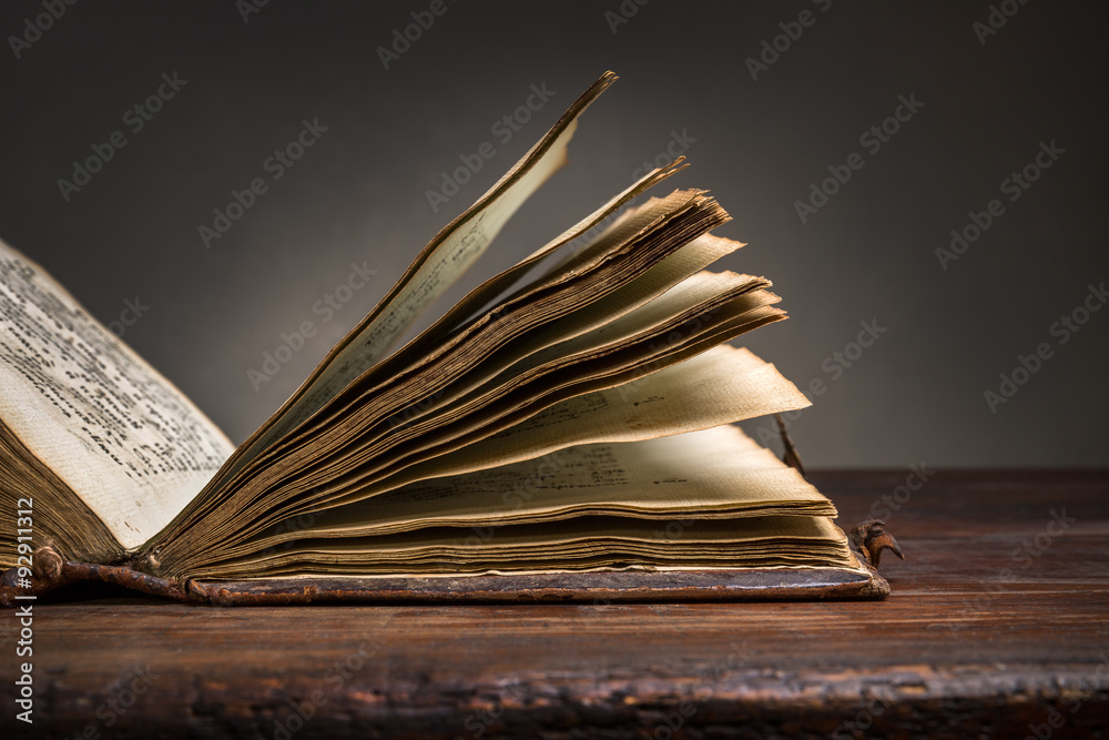 Fototapety, obrazy: Old Open Bible on old wooden table.