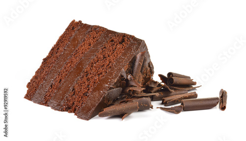 Chocolate cake slice with curl on white background Canvas Print
