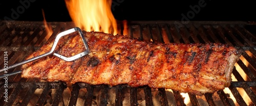 Fotografie, Obraz Baby Back Or Pork Spareribs On The Hot Flaming Grill