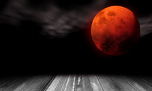 Blood Moon Concept Of Halloween Or Full Moon. Red Moon On Black Sky And Wood Floor. Elements Of This Image Furnished By NASA