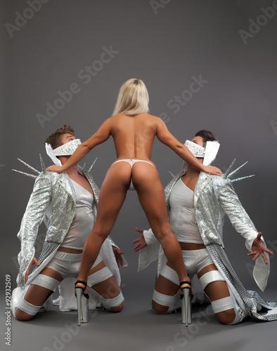 Fotografie, Tablou  BDSM dance. Nude dominatrix manages her slaves