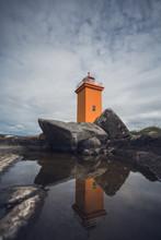 Orange Lighthouse At The Westcoast Of Iceland