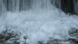 Water tumbles down to the base of a spillway of a small dam on a trout stream.