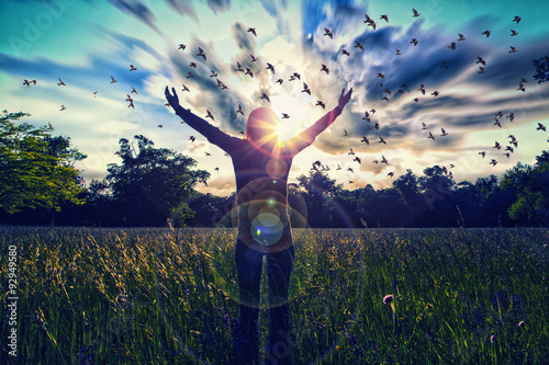 Obraz Young girl spreading hands with joy and inspiration facing the sun,sun greeting,freedom concept,bird flying above sign of freedom and liberty - fototapety do salonu