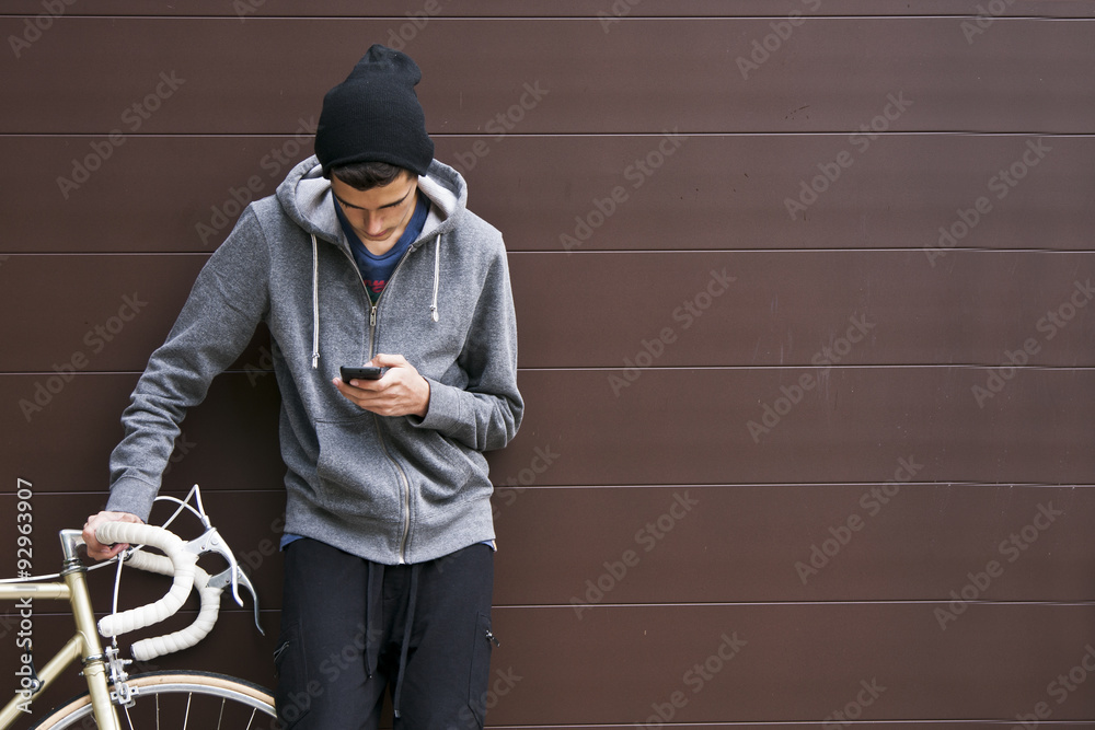 Fototapeta man with mobile phone and bicycle
