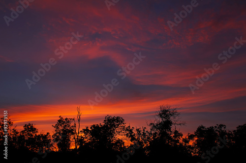Tuinposter Crimson dark cloudy sky at sunset
