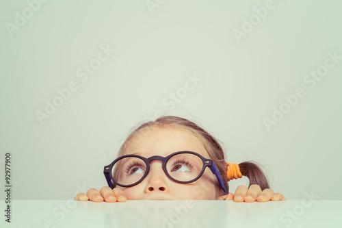 Fototapeta cute little girl hiding behind the table obraz