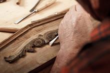 Close-up Of Senior Carpenter Restoring Old Furniture