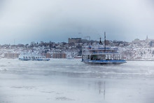 Ferry Boat In Ice On St-Lawrence River Between Quebec And Levis In Canada During Winter Season.