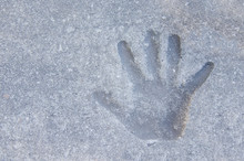 A Child's Hand Print That Was Made In A Sidewalk Before The Concrete Got Hard When The Sidewalk Was Being Constructed. Also Looks Like An Imprint In Mud Or Sand.