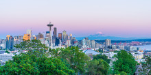 Seattle Skyline With Mount Rainier In The Background During Sunset.