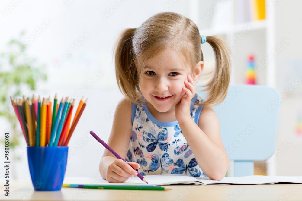 Fototapeta Cute little preschooler child drawing at home