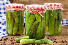 Jars Of Canned Pickles With Pe...