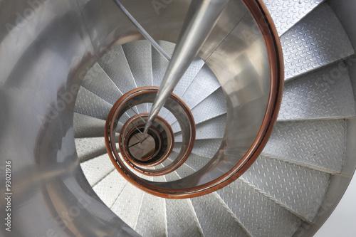 Foto op Plexiglas Trappen Metallic spiral stair with wooden handrails inside a lighthouse