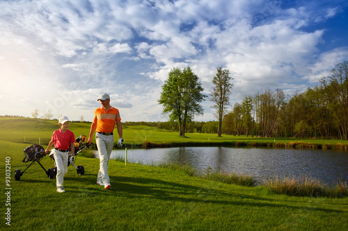 Poster Golf Father with son at golf field
