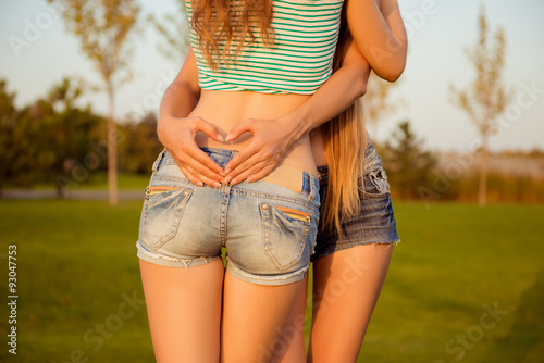 Ane Close-up photo of a girl showing a heart with fingers upon her g