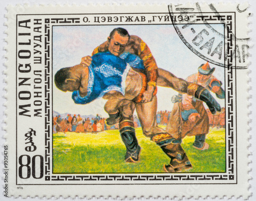 Fotografering  MONGOLIA - CIRCA 1976: A stamp printed in Mongolia shows two men fighting judo,