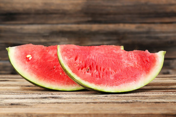 Tasty watermelon on brown wooden background