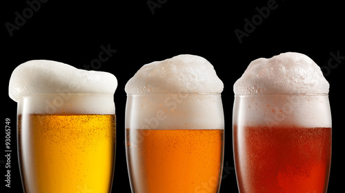 Foto op Canvas Alcohol Different beer in glasses isolated on black