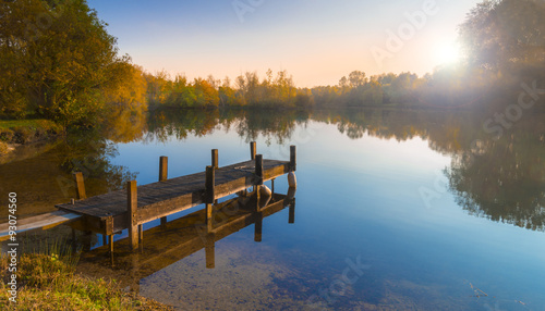 Photo Stands Lake Wooden Jetty on a Becalmed Lake at Sunset