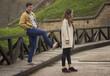 Boyfriend kicking girlfriend in back, prank. Funny shot.