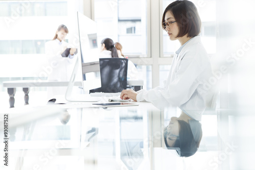 Fototapety, obrazy: Female doctor working in medical office