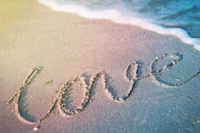 The Word Love On A Tropical Be...