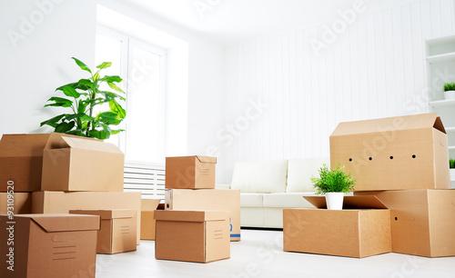 Fototapeta move. lots of cardboard boxes in empty new apartment obraz