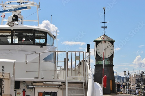 A motor boat and the clock tower in the harbor Pipervika in Oslo, Norway, Europe Poster