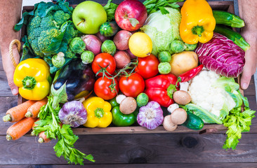 Vegetables and fruits in wood box.