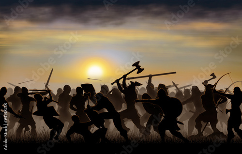 Fotografía  silhouettes fighting warriors are seen against the background of the rising sun