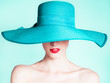 canvas print picture - Woman wearing hat. Fashion studio portrait