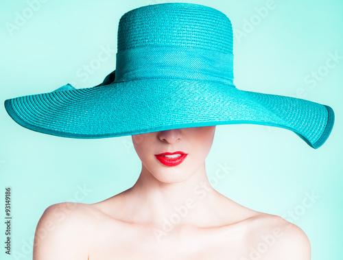 Fotografie, Obraz  Woman wearing hat. Fashion studio portrait