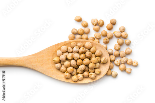 uncooked chickpeas in wooden spoon