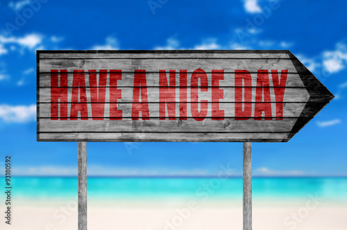 Photo  Red Have a Nice Day wooden sign with on a beach background
