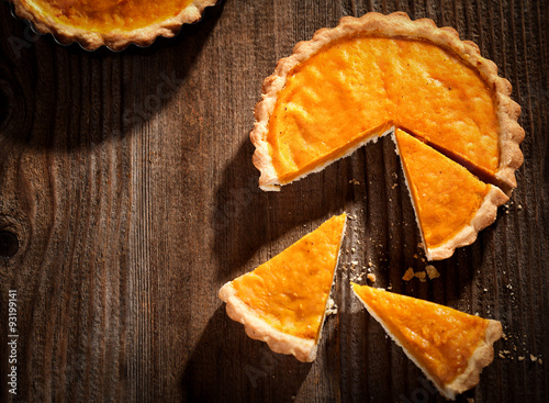Fotografia  Pumpkin pie on a rustic wooden table