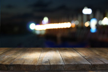 Image Of Wooden Table In Front Of Abstract Blurred Background Of Marina Yacht In Pier At Night