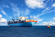 canvas print picture - Tugboats assisting container cargo ship to harbor.