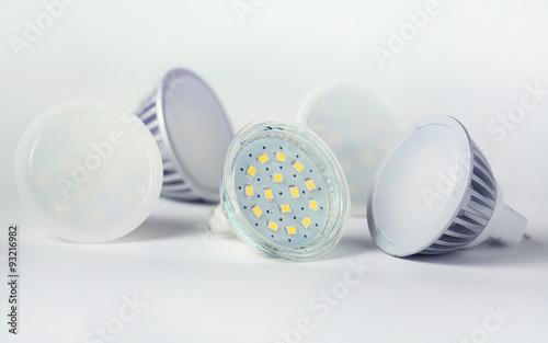 Valokuva  Group of led bulbs closeup on white background.