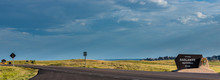 Badlands National Park Sign Road And A Fee Booth Panorama